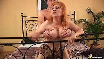 Slim brunette MILF undressing and teasing her pussy
